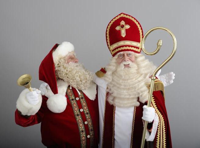 sveti nikola i djed božićnjak se grle